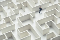 Business challenge. A businessman navigating through a maze. Top view Stock Photography