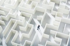 Business challenge. A businessman navigating through a maze. Top view Stock Images