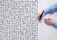 Business challenge concept. Businessman entering a maze and holding a marker, business strategy and challenge concept Stock Photography