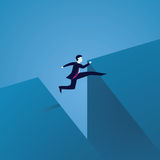 Business Challenge Concept. Businessman Jumping Over Gap Royalty Free Stock Photos