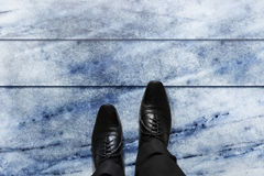 Business Challenge concept, Businessman steps, top view. Business Challenge concept, Black formal oxford shoes of businessman steps over marble floor with plenty Royalty Free Stock Photography