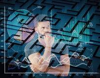 Business challenge concept. Thoughtful young man on abstract background with charts and maze. Business challenge concept. Double exposure Royalty Free Stock Images