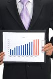 Business chart. Businessman presenting business chart Royalty Free Stock Photo