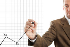 Business chart. Isolated businessman writing diagram, focus point on nearest part of pen royalty free stock photography