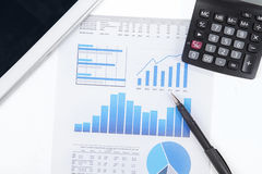 Business chart, calculator, and digital tablet Stock Images