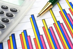 Business chart, calculator and pen Stock Image