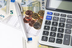 Business chart with calculator, pen and coins Stock Images