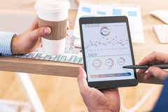 Business chart and coffee Stock Photo