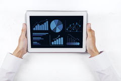 Business chart on digital tablet screen 1 Royalty Free Stock Images
