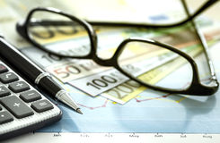Business chart and eyeglasses Stock Photos