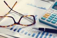 Business chart and eyeglasses Royalty Free Stock Photos