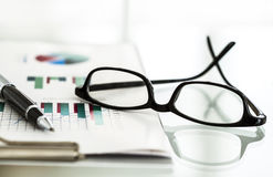 Business chart and eyeglasses Royalty Free Stock Photography