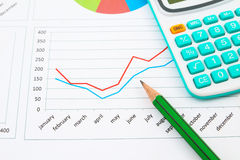 Business chart. With green pencil and calculator Stock Photo