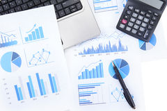 Business chart with laptop and calculator Stock Photography