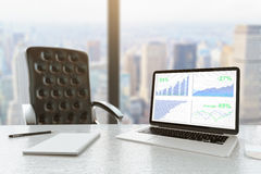 Business chart laptop city view Stock Image