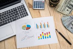 Business chart, laptop, pen, dollar and calculator. Office workplace - business chart, laptop, pen, dollar and calculator Stock Photography