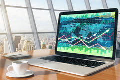 Business chart on laptop screen with diary and cup of coffee on. Wooden table, close up Royalty Free Stock Images