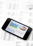 Business chart on mobile phone Royalty Free Stock Images