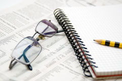 Business chart. Newspaper,pad and eyeglasses Royalty Free Stock Image