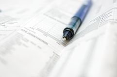 Business chart. Newspaper and pen Stock Image
