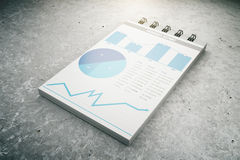 Business chart on notepad page on concrete floor. 3D Render Stock Photography