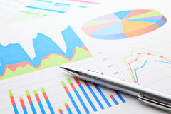 Business chart with pen Stock Images