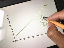 Business chart. Profit planning dollar on the board drawing graph Stock Images