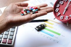 Business chart report and pills Stock Photo