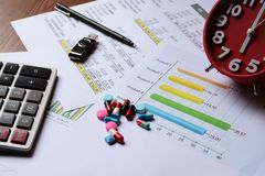 Business chart report and pills Stock Photography