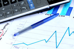 Business chart showing financial growth. Pen placed over financial statistics and charts stock illustration