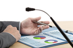 Business chart showing financial with microphone Stock Images