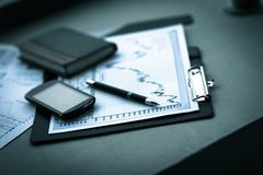 Business chart with smart phone and pen. accounting Royalty Free Stock Photography