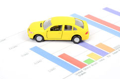 Business chart and toy car Royalty Free Stock Photos