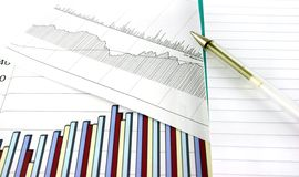 Business Charts. Business chart and graphs with a notepad next to them Stock Images