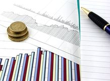 Business Charts 2. Business chart and graphs, with a notepad and pen beside Stock Image