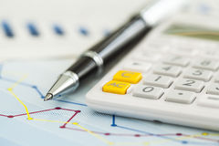 Business charts and calculator Stock Images