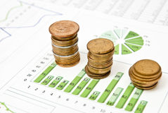 Business charts and coins Stock Photography