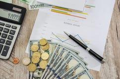 Business charts, euros, dollars, calculators and coins. View from above. Business charts, euros, dollars, calculators and coins stock images
