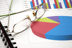 Business Charts With Glasses Royalty Free Stock Image