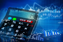 Business charts and graphs. Calculator with business charts and graphs Stock Image