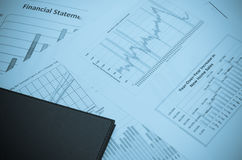Business charts and graphs cyanotype style Royalty Free Stock Photo