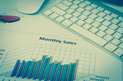 Business charts or graphs with keyboard vintage style Stock Image