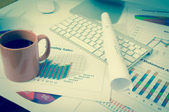 Business charts or graphs with keyboard vintage style Royalty Free Stock Images