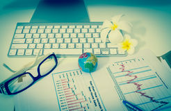 Business charts or graphs with keyboard vintage style Royalty Free Stock Photo