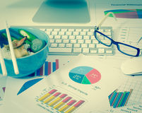 Business charts or graphs and lunch with keyboard vintage style Royalty Free Stock Images