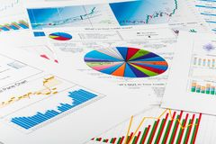 Business graphs and charts, business background on. Business charts graphs white closeup financial market Stock Photos
