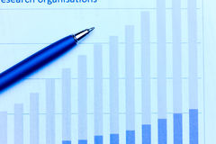 Business charts and pen Stock Photos
