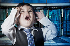 Business, child dressed businessman with hands in his tie and sk Stock Photo