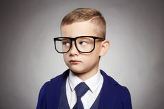 Business child in formal suit and glasses Royalty Free Stock Images