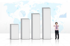 Business child next to a graph Stock Photo